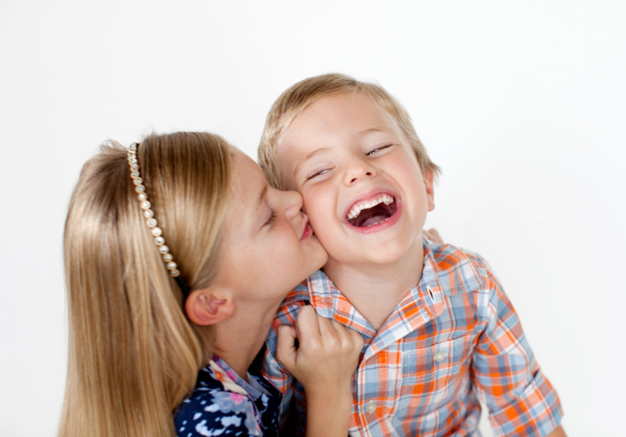 two young kids laughing